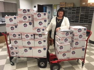 Program Coordinator Pam Gray with 26 Patriot Packages totaling 225 lbs. sent this year from CoreCivic headquarters in Nashville.
